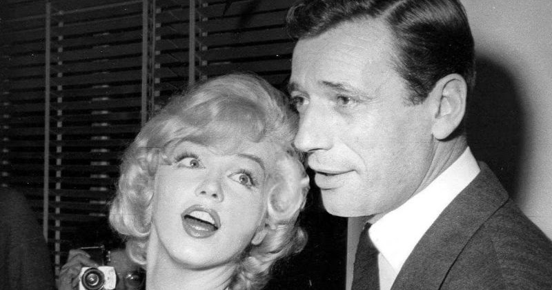 "Photos of Marilyn Monroe and Yves Montand at a Press Party for ""Let's Make Love"" in 1960"