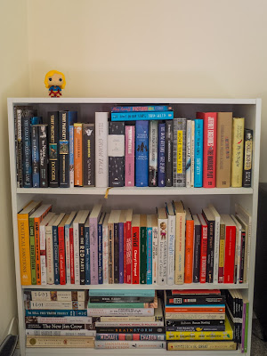 White bookcase with Supergirl Pop figurine on top