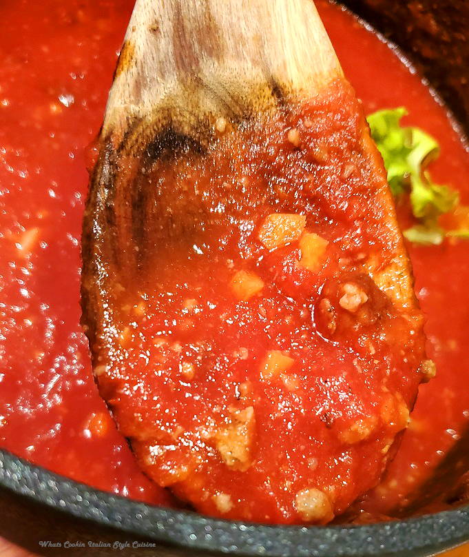 this is a pan of fresh tomatoes with meat in it called bolognese sauce to go on top of pasta