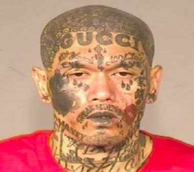 Gang member with Gucci tattoo on his forehead captured in ...
