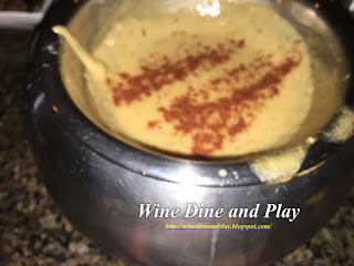 Cheddar and Emmenthaler cheese with Bavarian mustard went into the Oktoberfest fondue at the Melting Pot restaurant in St. Petersburg, Florida.