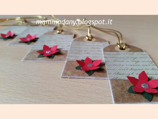 tags chiudi-pacco di natale con stella rossa e oro
