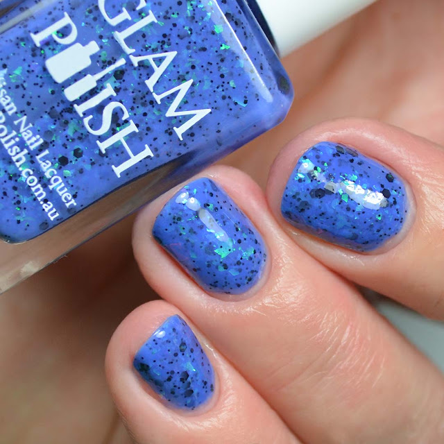 blue nail polish with color shifting flakies three finger swatch
