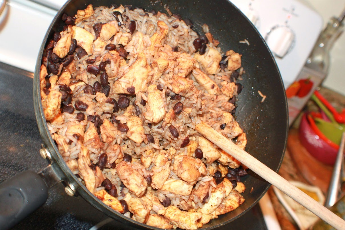 A big pan of black beans and rice with sauteed chicken