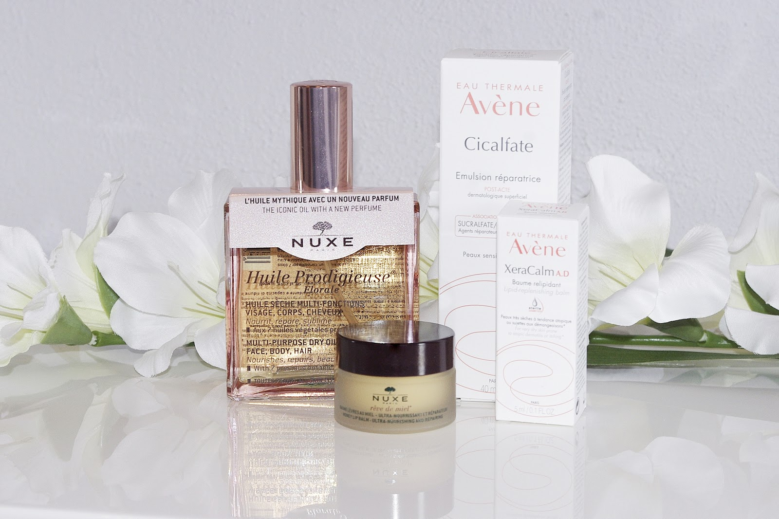 Prodigeuse Florale Nuxe Reve de Miel Honey Lip Balm Avene Cicalfate Post Acte Emulsja Regenerująca