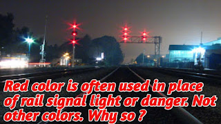 Red color is often used in place of rail signal light or danger. Not other colors. Why so ?