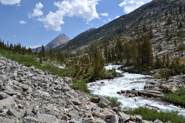 rushing creek and a peeking peak