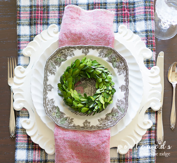 small preseved boxwood wreath, brown transferware, white wood charger, Christmas table setting