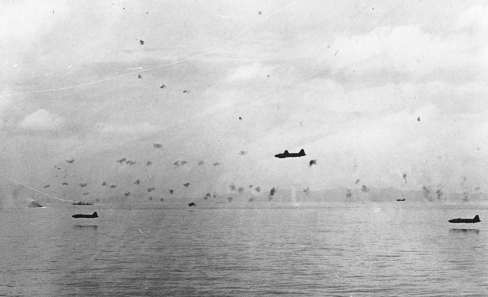 Japanese bomber planes sweep in very low for an attack on U.S. warships and transporters, on September 25, 1942, at an unknown location in the Pacific Ocean.