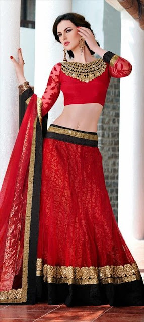 Beautiful Model Girl In Red And Maroon Color Lehenga Choli. This Style Of Lehenga Choli Is Quiet Famous In South Asian Countries Specially India, Because Of It's Beautiful Design And Color Combination.