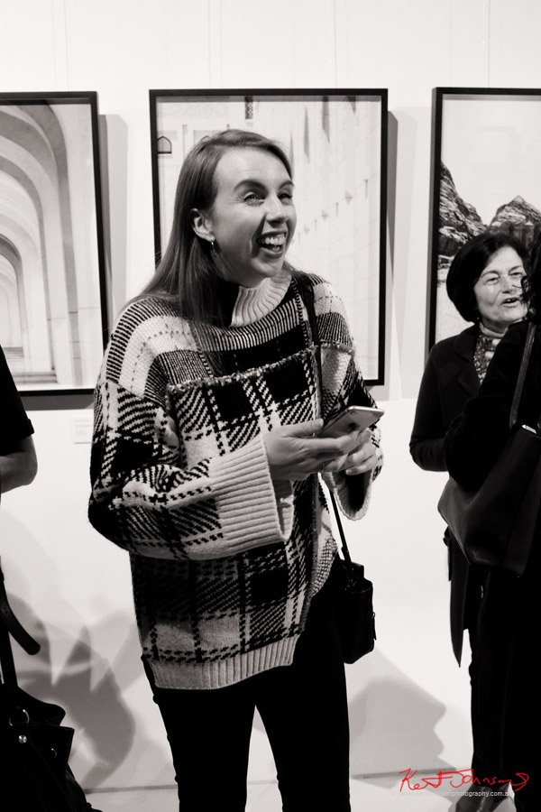 A happy woman attending the show. Photography by Kent Johnson for Street Fashion Sydney.