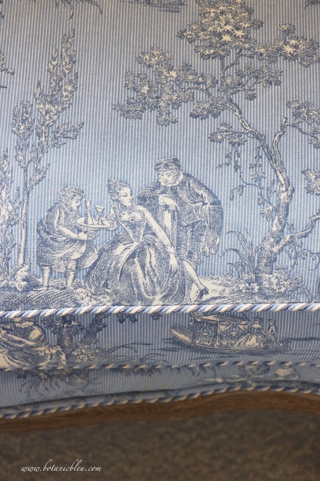 French Country blue and white toile fabric bench is upscaled with coordinating braided cording