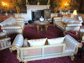 The Tapestry Room with 1820s giltwood furniture  and a white marble chimneypiece by Adam