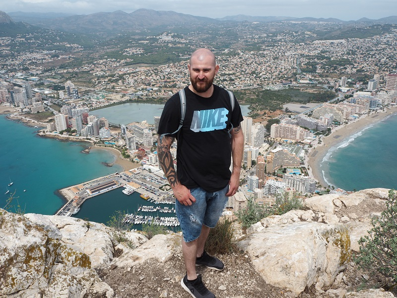 Gordon standing at the top of Penon de Ifash (Calpe Rock)