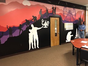 Artistic murals capture essence of exciting local school that helps student succeed