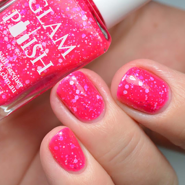 bright pink nail polish with glitter swatched