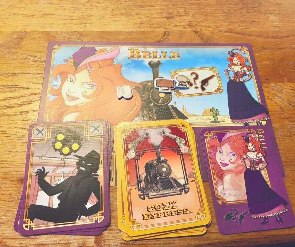 Colt Express Belle player board with bullet cards, activity cards, and bonus card as well as a money bag and suitcase.