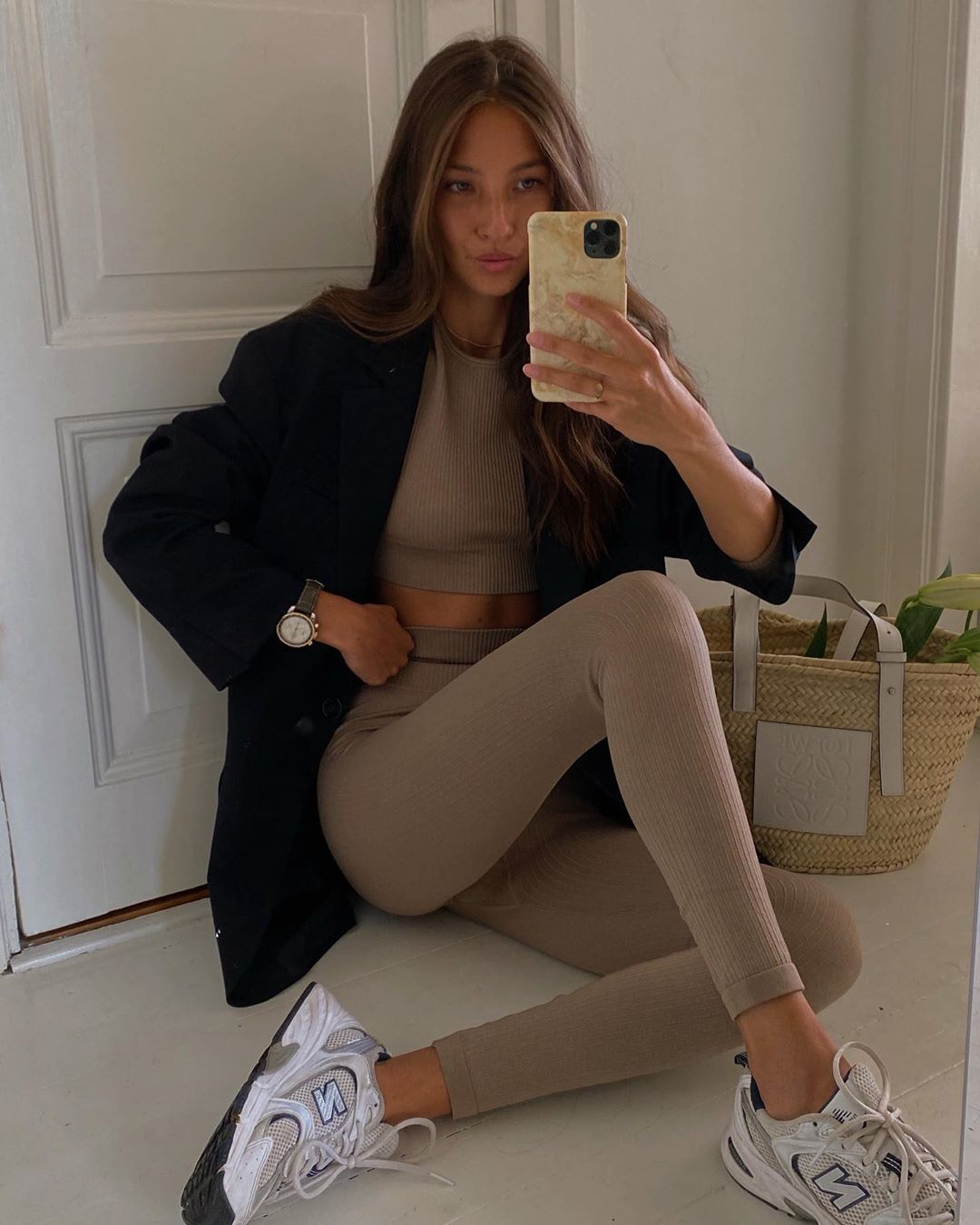 Felicia Akerstrom in a stylish activewear outfit — loungewear style with neutral ribbed top and matching leggings
