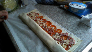 Pizza Rolls: pastry with pizza sauce, salami and cheese. Middle of coiling up