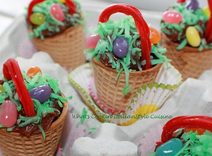 these are ice cream cone baskets for Easter filled with cake, frosting and jelly beans