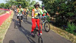 Anggota Kodim 0719 Jepara Gowes Keliling Kampung warga