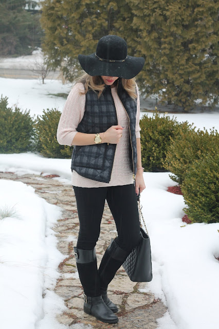 pink sweater, plaid vest, black jeans, black riding boots, Greg Michaels tote, floppy hat