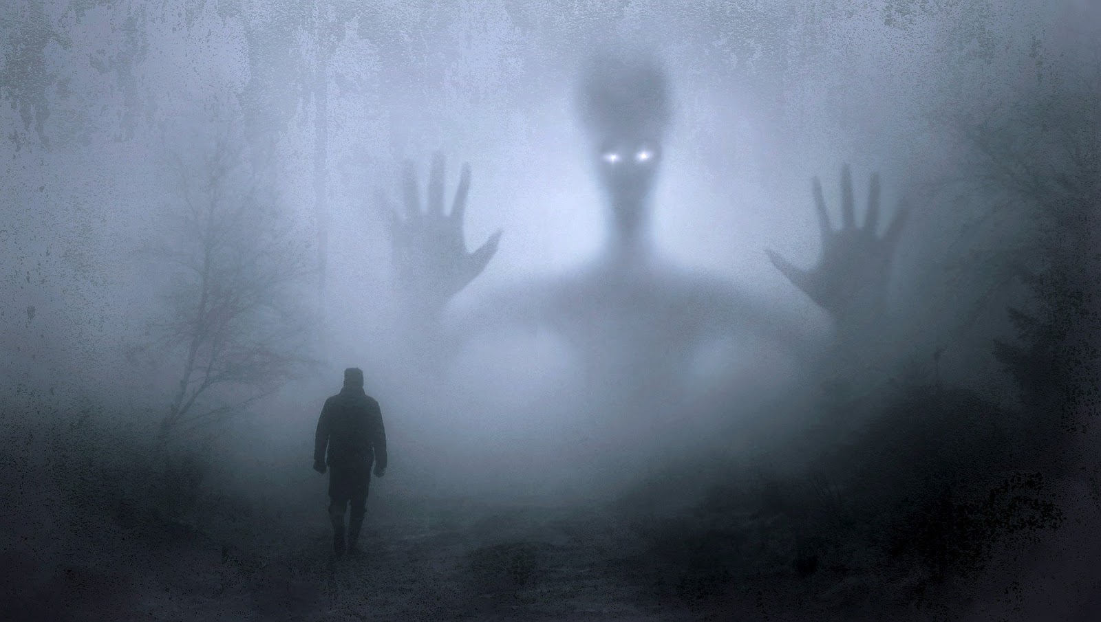 a small man walks through a foggy forest with the shape of an alien in the sky for blog post about extraterrestrial warfare