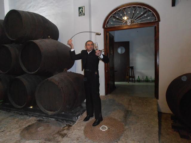 pouring fino wine at El Alfoli, montilla-moriles, Lucena
