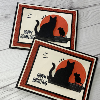 Halloween card showing mouse and cat in silhouette looking at the moon