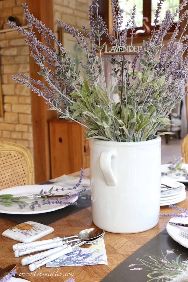 Whimsical Summer Lavender Tablesetting is kept magical with whimsical paper placemats