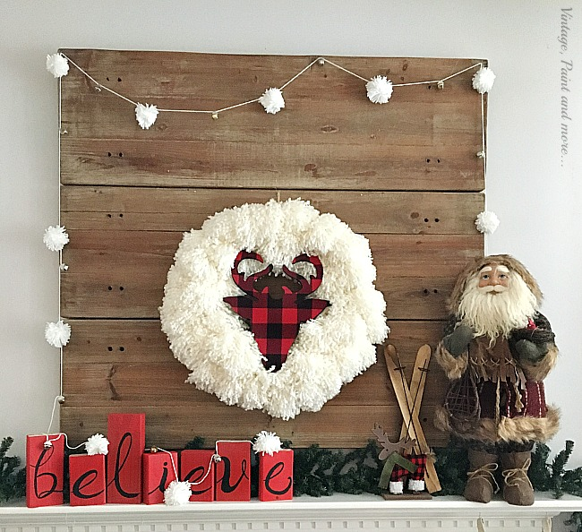 Vintage Paint and more... a Christmas mantel done with a diy yarn pom pom wreath and garland and rustic Christmas pieces