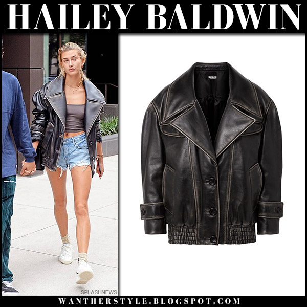Hailey Baldwin in black leather oversized jacket miu miu and denim shorts model street style september 14