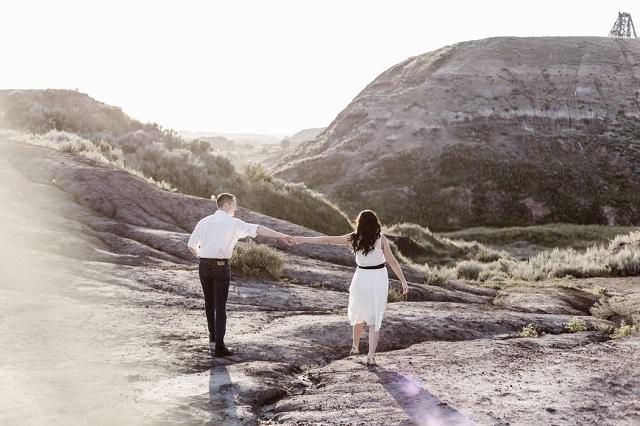 man woman walking in the field