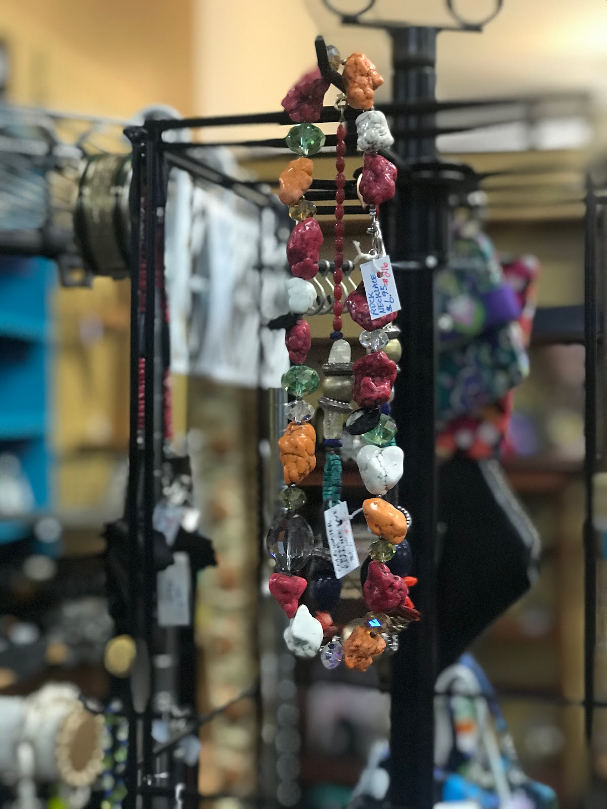 Image: Earrings Hanging at Thrift store. Picture taken by Tangie Bell. Self-care tips tricks and hacks. Being Forty-Something