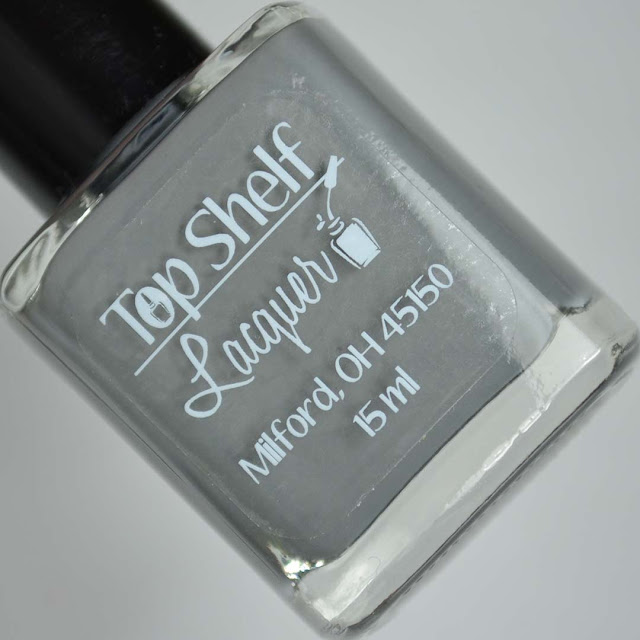 grey nail polish in a bottle