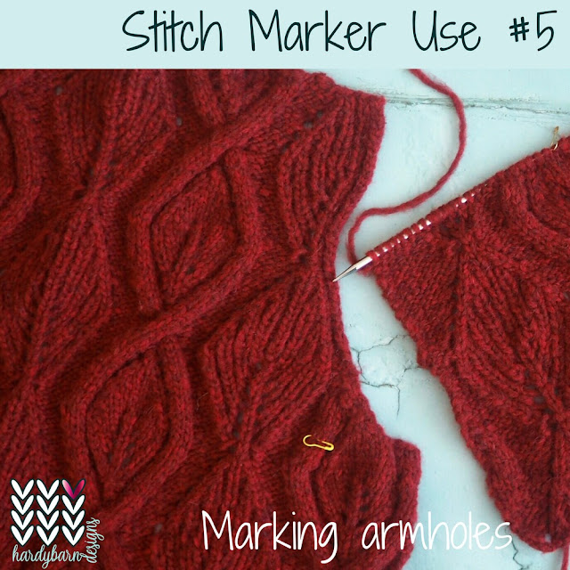 Red cabled knitting with yellow marker at armhole