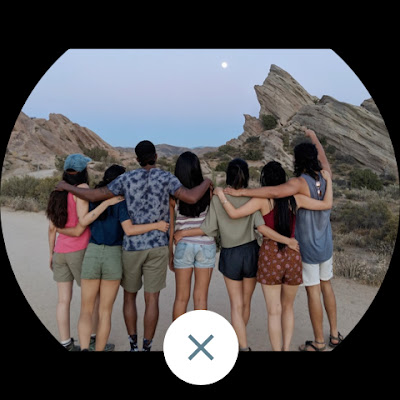 7 people looking up at the sky