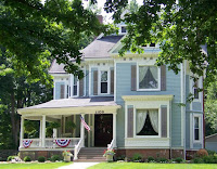 Blessings on State Bed & Breakfast, a historic Victorian Mansion on a sunny day with patriotic bunting and American flag flying