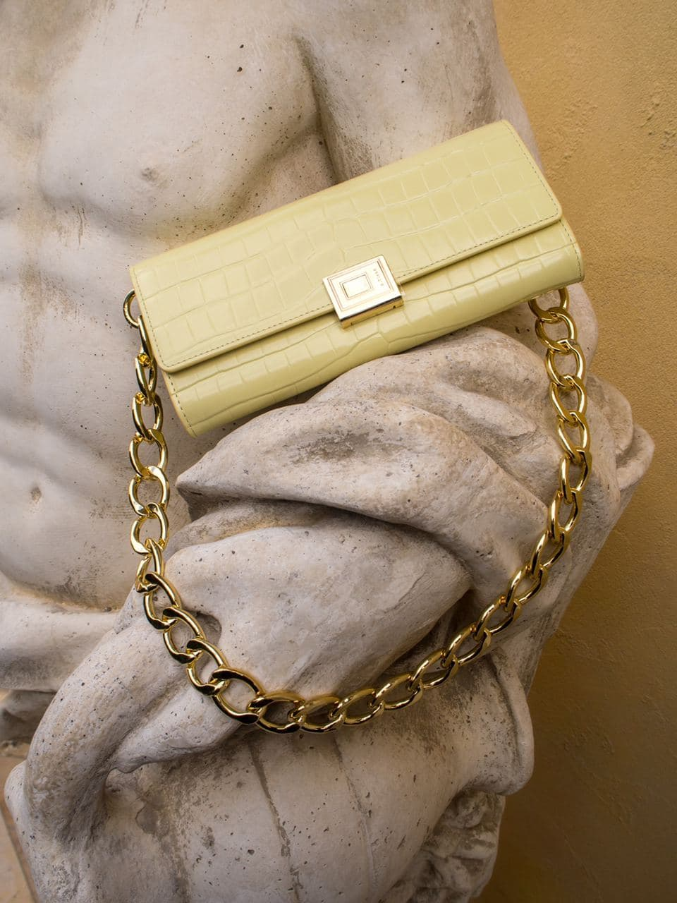 bag, yellow bag, a.cloud milano, roman statue, photoshoot, editorial, vanilla custard color, yellow clutch bag