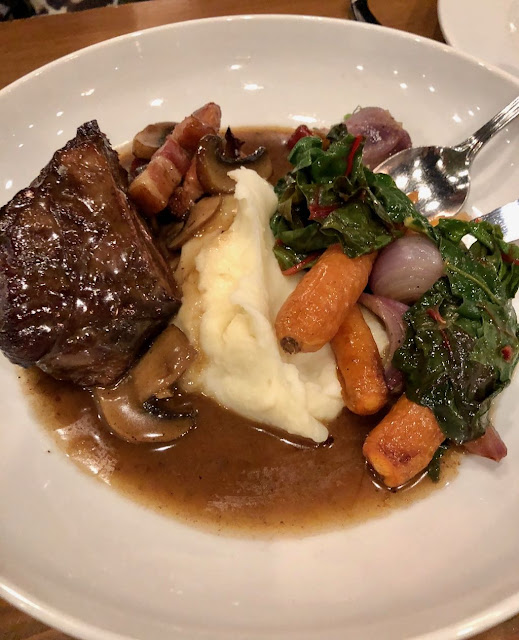 Braised Short Rib Bourguignon - with roasted carrots, mushrooms, lardons, potato puree & wilted greens at the Marc Edmonton