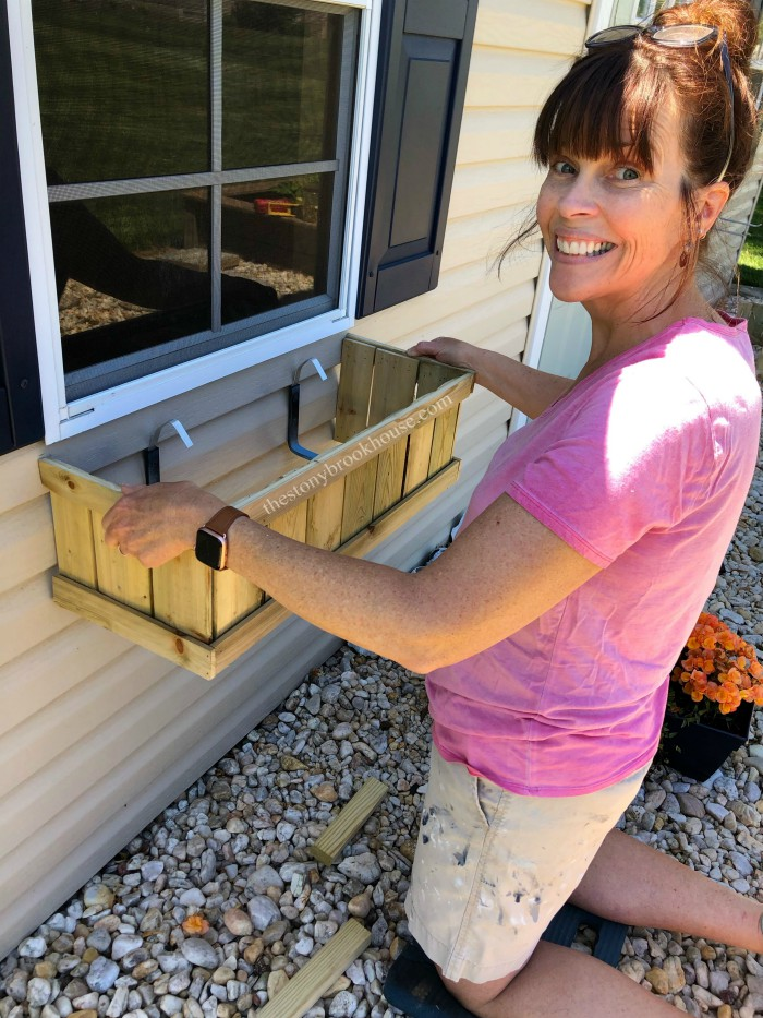 Attaching window boxes to shed