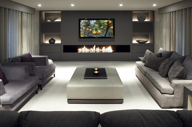 wonderful media room ideas with modern fireplace under wall mounted 3d tv and gray fabric sectional sofa plus big armchairs also modern white leather coffee table