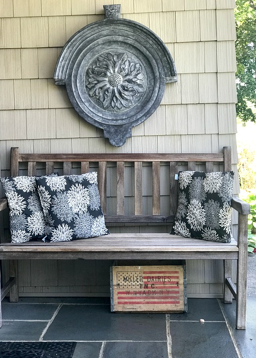 front stoop with teak bench and pillows