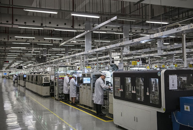 Workers are seen on the production line