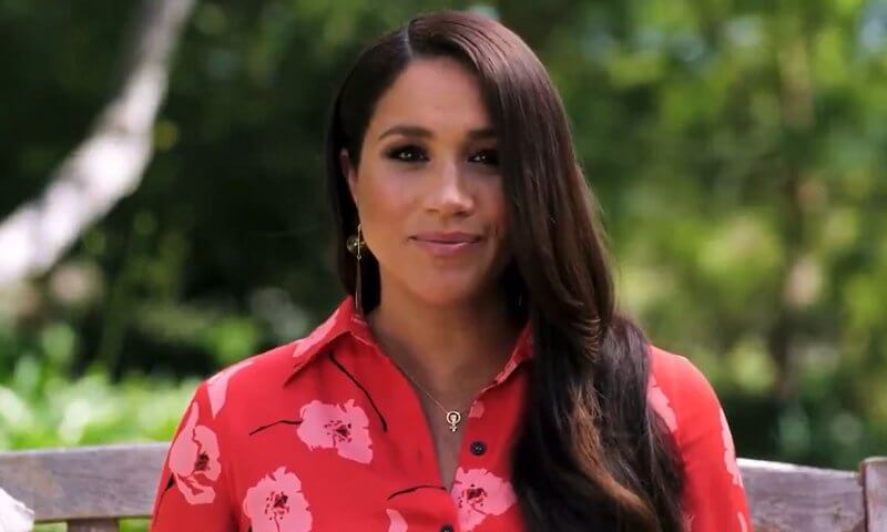 Meghan Markle wore a red shirt dress from Carolina Herrera and a Woman Power statement necklace from Awe