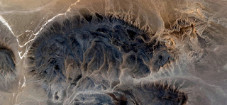 Desert veins, abstract landscapes of deserts of Africa from the air, mirage in the Sahara, ocher textures with white lines,