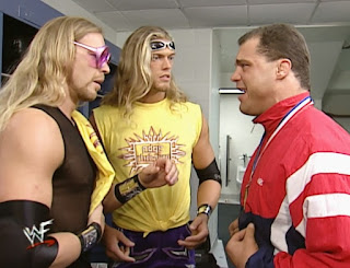 WWE / WWF Survivor Series 2000 - Kurt Angle confers with Edge & Christian backstage