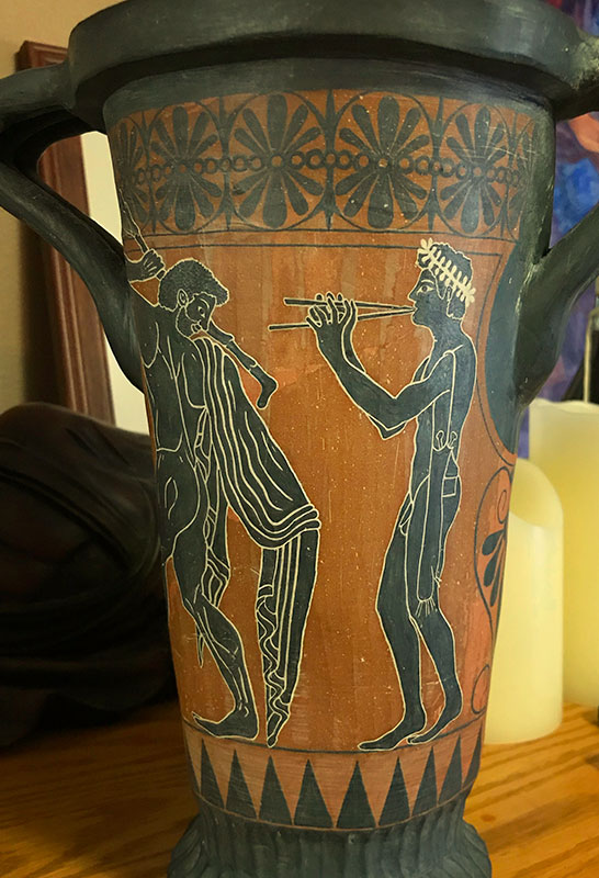 Greek Vase painting close up, boy playing flute, greek dancers