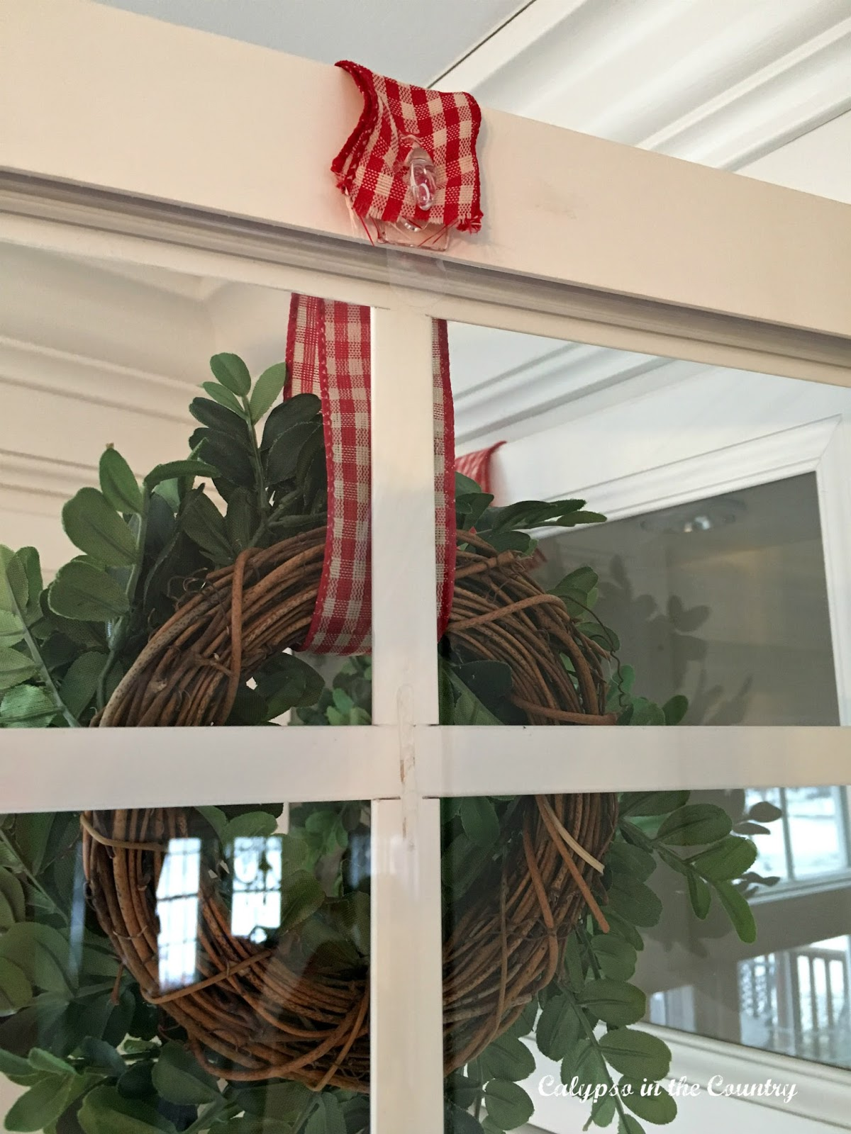 How to Hang a Wreath on Kitchen Cabinet Doors