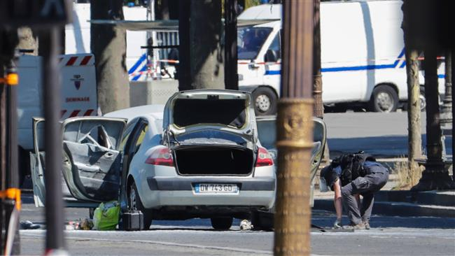 Car rams police vehicle on Paris' Champs-Elysees, attacker dead